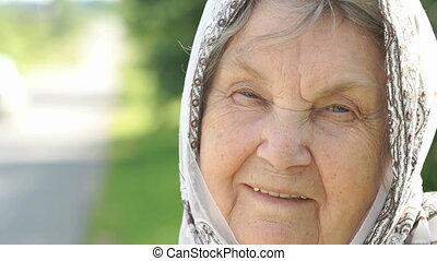 Portrait of smiling mature elderly woman. Close-up
