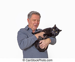 portrait of smiling mature man with cat in his arms
