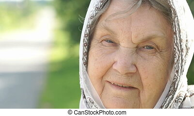 Portrait of smiling mature old woman. Close-up