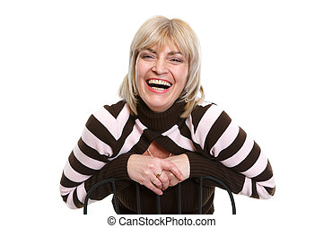 Portrait of smiling middle age woman sitting on chair