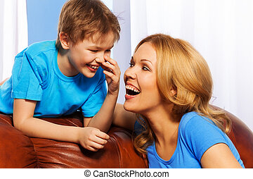 Portrait of smiling mother and son at home