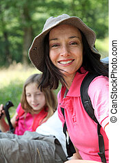 Portrait of smiling mother on a hiking day