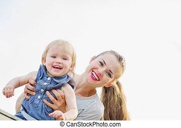 Portrait of smiling mother with kid