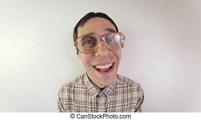 Portrait of smiling nerd in glasses - Funny nerd talking ...