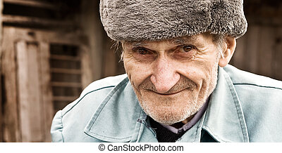 Portrait of smiling old man - Close-up portrait of smiling...