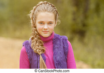Portrait of smiling pretty girl walking in park