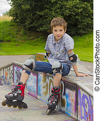 Portrait of smiling rollerskater in protection kit