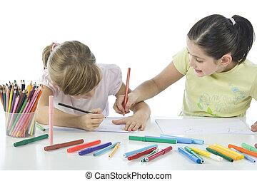 Portrait of smiling schoolchildren draws a picture.