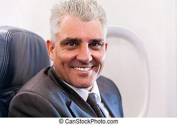 senior businessman on airplane
