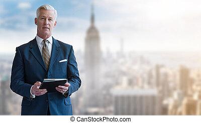 Portrait of smiling senior businessman