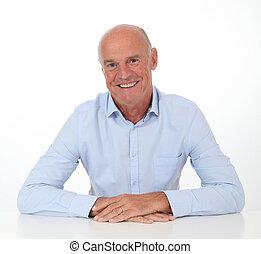 Portrait of smiling senior man on white background