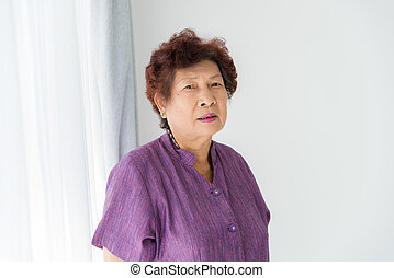 Portrait of smiling senior woman at home.
