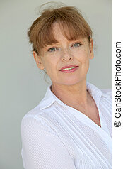Portrait of smiling senior woman on white background