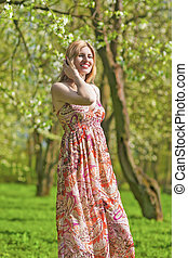 Portrait of Smiling Sensual Blond Woman in Spring Forest Outdoors.
