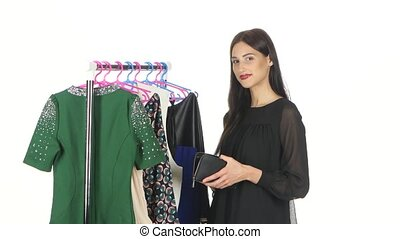 Portrait of smiling shopping woman with clothes and credit card. White