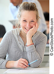 Portrait of smiling student girl in class
