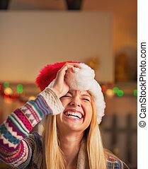 Portrait of smiling teenage girl in santa hat