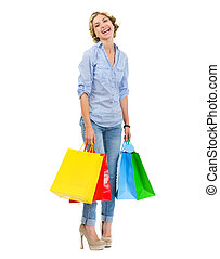 Portrait of smiling teenage girl with shopping bags