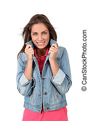 Portrait of smiling teenager on white background