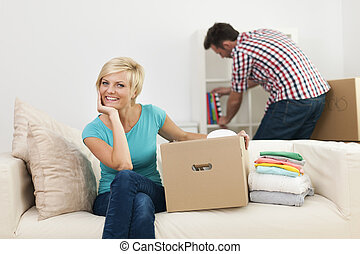 Portrait of smiling woman during the decorating new living room