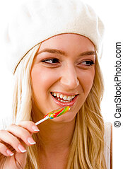 portrait of smiling woman going to eat candy