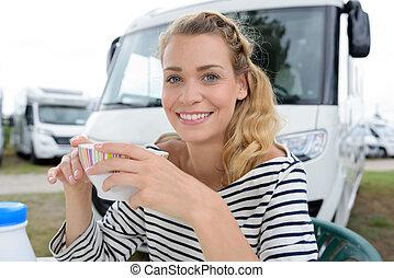 portrait of smiling woman having breakfasts