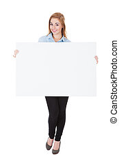 Portrait Of Smiling Woman Holding Placard Over White Background