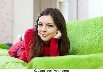 woman in red dress at home