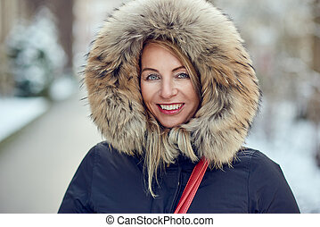 Portrait of smiling woman wearing winter hood
