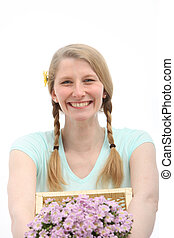 Portrait of smiling woman with pink flowers