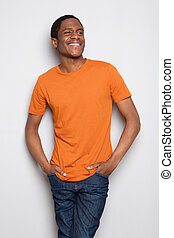 smiling young african american man standing against white background