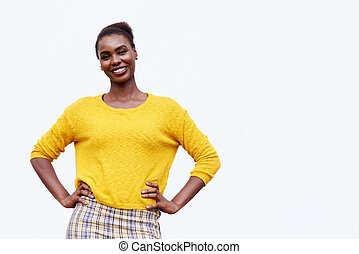 smiling young african american woman posing against isolated white background