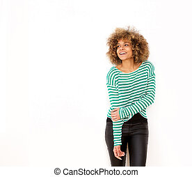 smiling young african american woman standing against white background