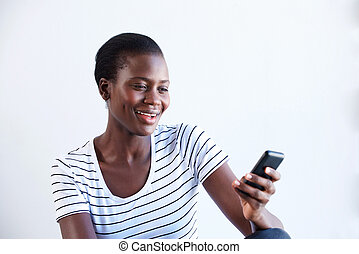 smiling young african woman using smart phone