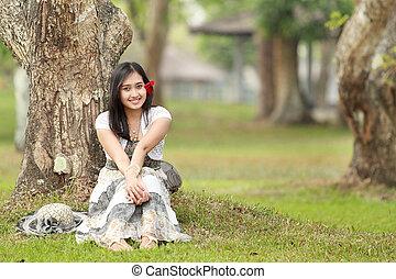 smiling young beautiful girl relaxing