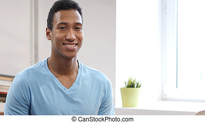 Portrait of Smiling Young Black Man
