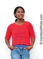 smiling young black woman leaning against white wall