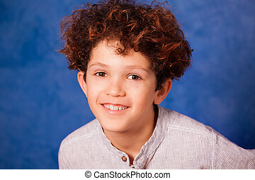Portrait of smiling young boy looking at camera