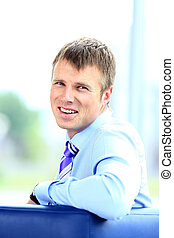 Portrait of smiling young businessman at office.