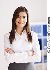 Portrait of smiling young businesswoman at office