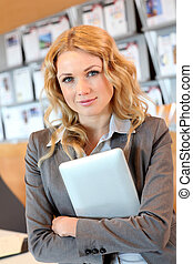 Portrait of smiling young businesswoman in office