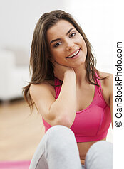 Portrait of smiling young fitness woman