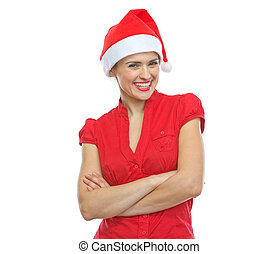 Portrait of smiling young woman in Santa hat