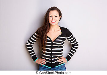 smiling young woman in striped sweater