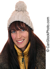 Portrait of smiling young woman in winter with cap