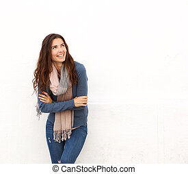 smiling young woman looking away at copy space on white background