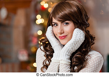 young woman near christmas tree