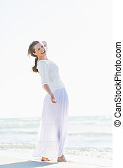Portrait of smiling young woman on beach