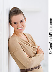 Portrait of smiling young woman standing in living room