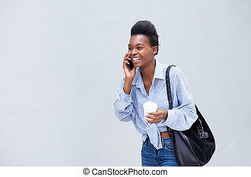 smiling young woman talking on mobile phone